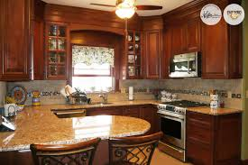 cinnamon shaker kitchen cabinets there u0027s something about darker woods like our elite cabinets in