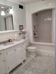 mortgage loans caroline gerardo home white bathroom remodel all four of these bathrooms are light and bright they use combinations of carrera marble white prefabricated vanities and pale blue and grey accents