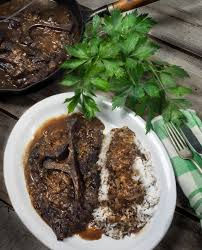 Steak Drapes Seven Steak And Onion Gravy Is A Traditional Cajun Roots Recipe
