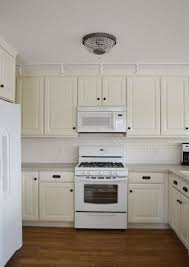 soft and sweet vanila kitchen design stylehomes net best 25 hanging kitchen cabinets ideas on kitchen