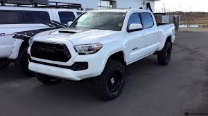 white toyota truck lifted 2017 toyota tacoma with a trd pro grill on 275 70r17 tires