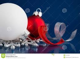 white silver and red christmas ornaments on dark blue background