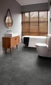 bathroom featuring secura pur luxury vinyl sheet flooring in