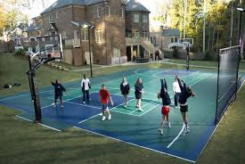 Backyard Tennis Courts Bring The Game Home With A Backyard Sports Court Hgtv