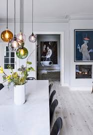 dining room lighting design beautiful pendants over the dining table in different colors