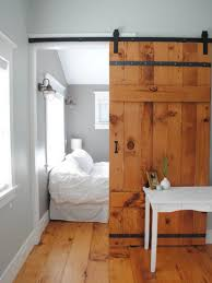 barn door bed while much of the furniture in this master bedroom