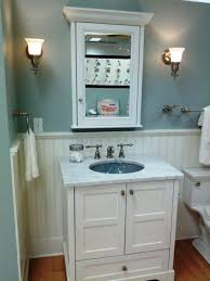 white toilet black small real wood vanity with granite countertop