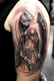 black shoulder tattoo black tiny tribal sun tattoo on left shoulder