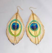 peacock feather earrings s white peacock feathers handpainted leather feather earrings