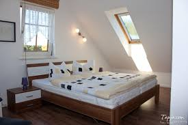 white fabric foam mattress small attic bedroom ideas black iron