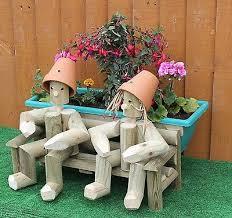 flowerpot men garden ornament handmade in uk wooden bench garden