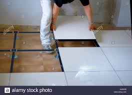 worker carries a floating floor on steel resting on the