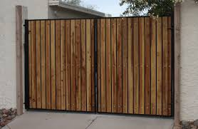 iron gates w wood martins fencing fabricating and installing