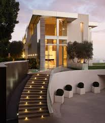 modern house entrance glass door on the cream gray house combined with brown stairs and