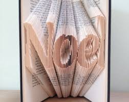folded book art pattern featuring the word