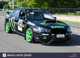 rally subaru a subaru impreza rally car at speed stock photo royalty free