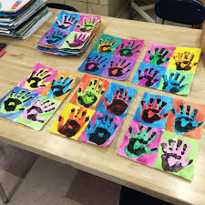 first graders finishing up their andy warhol inspired hand artwork
