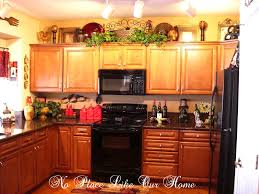 what do you put on top of kitchen cabinets best elegant ideas of what to put on top kitchen ca 4753 what to