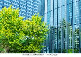 modern office building green trees stock photo 437526940