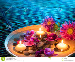 dish spa with floating candles daisys orchid on mat stock image