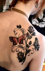 black roses and butterfly tattoo on right back shoulder