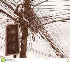 messy electrical cables and wires on electric pole in front of the