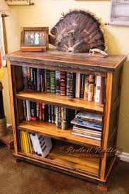 wood bookcase with a weathered finish and 14 compartments in