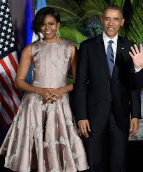 does michelle obama wear hair pieces michelle obama dances the tango in a shimmery dress at argentina s