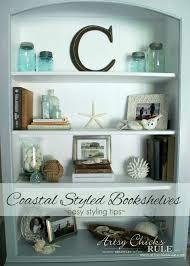 how to style a bookcase coastal styled bookshelves how to style shelves artsy rule