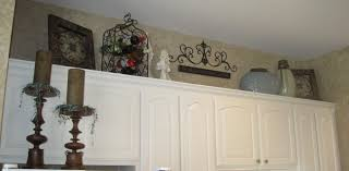 Space Above Kitchen Cabinets Ideas Ideas For Decorating The Top Of Kitchen Cabinets By Terrie