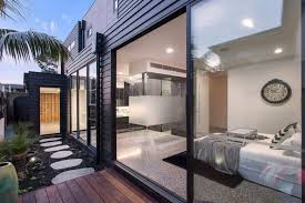 Define Interior Design by Bold Square Shapes On The Exterior And Contemporary Interior
