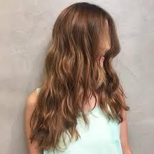 v cut layered hair women s long wavy v cut layers on warm light brown hair