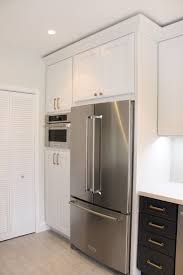 kraftmaid dove white kitchen cabinets i our new contrasting midnight blue and dove white
