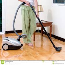 vacuum the carpet housewife cleaning floor with vacuum cleaner stock image image