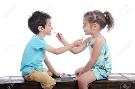 boy and face painting one another siting on a bench in a