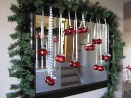 love this idea hanging decorations in front of or on a mirror i