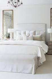 chic white bedroom with upholstered headboard matching geometric