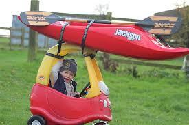 Triumphant Baby Meme - psbattle a triumphant kid with a kayak on top of his car