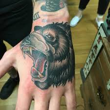 tattoos in hand bear on my hand by derek noble at dark age tattoo in seattle