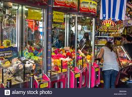 arcade with claw crane game machines filled with toys at