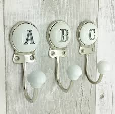 coat hooks and pegs wall key hooks notonthehighstreet com ceramic alphabet or number letter wall coat rack hook home decorating
