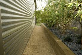 corrugated metal planter box landscape midcentury with river rock