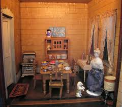 a rare 19th century doll house with a mysterious past by susan here is the kitchen with its original wallpaper fido is always begging the cook for treats most of the furniture in here is schneegas golden oak