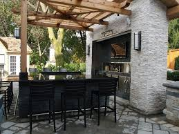 wooden pergola above contemporary outdoor bar design with black
