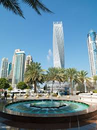cayan tower and modern buildings at dubai united arab emirates