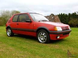 peugeot gti 1980 205 1 9 gti in cherry red the best hatch pocket rocket now