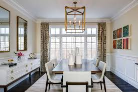 formal dining room with wall decor including canvas arts and