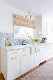 sink faucet moroccan tile kitchen backsplash countertops mirror