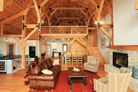 the natural rough cut wood is exposed is this gambrel barn home
