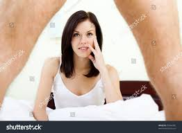 young woman looking under man leg stock photo 97464305 shutterstock young woman looking under man leg sho k sitting on bed in her